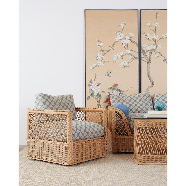 Rare pair of organic modern rattan wicker lounge chairs or club chairs made by McGuire. Features a cube style rattan and...