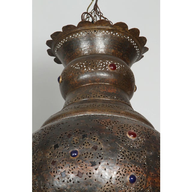 Large Moroccan bronze patina pendant. This large Moorish chandelier is delicately hand-carved and hand-hammered with...