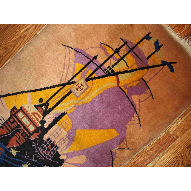Decorative Chinese Art Deco rug with an image of a ship. Very well detailed, this beautiful rug is combining different...