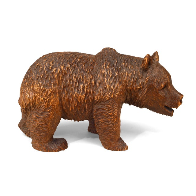 Small turn of the century rustic Black Forest style carved walnut small figure of a walking bear with face pointed down...