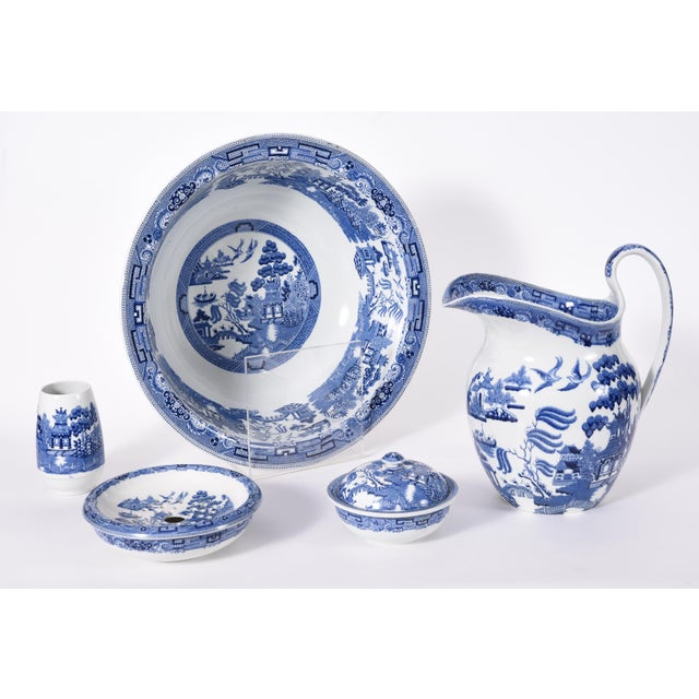 Wedgwood England Porcelain five piece set. Each piece is in excellent vintage condition, maker's mark undersigned. The...