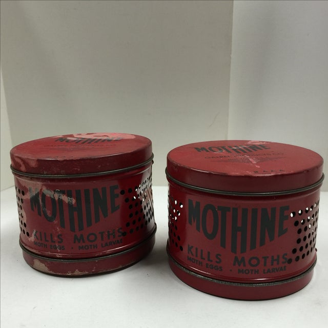 Great decor items! A pair of vintage red Mothine tins.