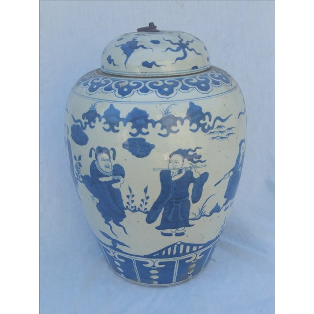 A Chinese large ginger jar. Hand decorated with typical Chinese characters. Rustic bubbled mat glaze.