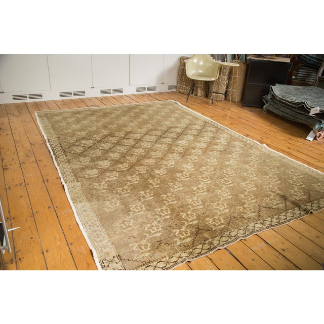 This rug showcases an all-over repeating flower design displayed within repeating, lattice-oriented panels. Featuring...