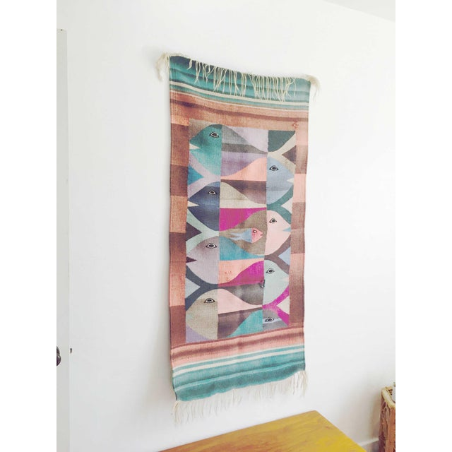 A beautiful vintage hand loomed weaving. A bold design of fish has been woven together in lovely pastel colors. Perfect...