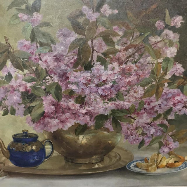 This antique Russian still life showcases a brass vase of cherry flowers and oranges in the brilliant soft hues of pink...