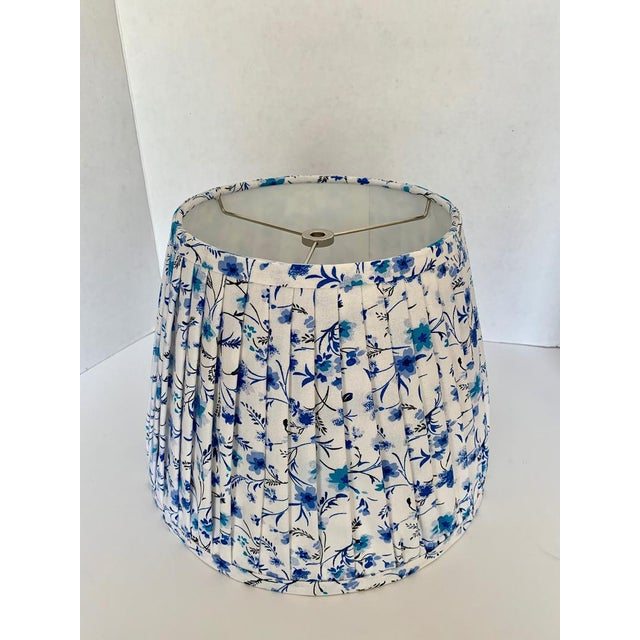 - New, custom, handcrafted lampshade - Fabric: Floral Fabric. Colors include white, and blue. - Lining: White Lining -...