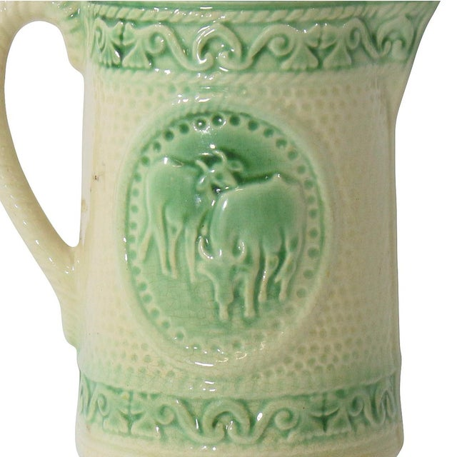 Offering a charming antique pitcher, originally used for water or milk at the kitchen table. Crafted of ceramic with...