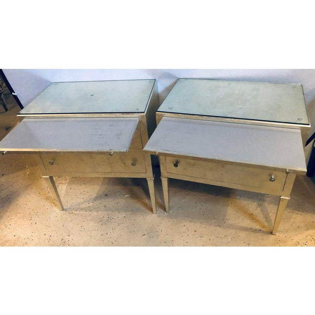 A stunning pair of Hollywood Regency style silver gilt commodes or chest of drawers or nightstands. These Mid-Century...