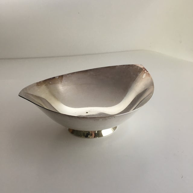A handsome vintage Cohr Denmark stylized bowl made from electroplated nickel silver. The Danish Modern styling on this...