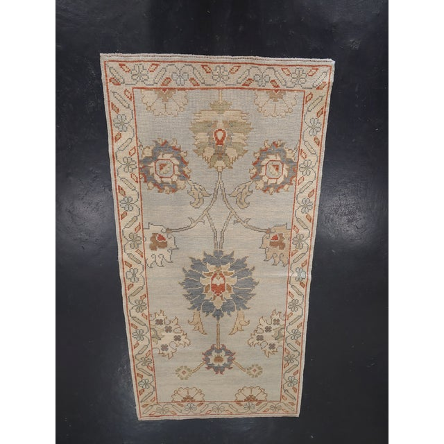 A Mill favorite! Swoon all of your dinner guests with this fabulous handmade Turkish rug. Handmade from the mid 20th...