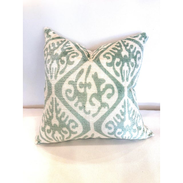 This pair of pillows features the ikat design in shades of cream and sea foam on velvet fabric with a solid linen back....