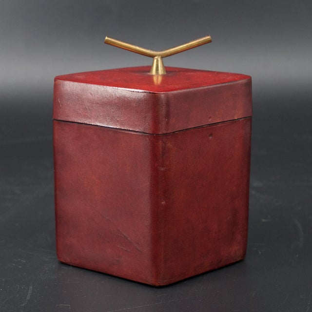 Wonderful small leather wrapped box with brass handle, for trinkets, etc