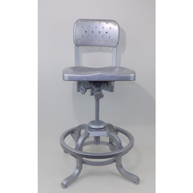 Early 1950's era Good Form Swivel Drafting Stool. Original upholstery was removed to show the gorgeous pierced industrial...