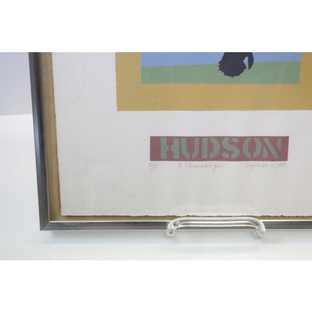 Framed print of 2 ducks in flight on white matte, silver frame, and glass covering. Labeled Hudson. Art deco style.