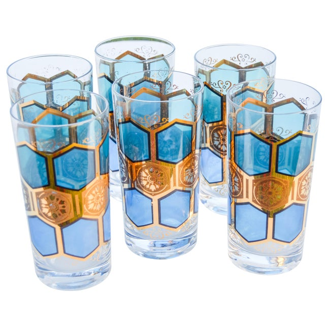 Set of six Midcentury highball glasses with an intricate pattern in gold and blues. Marked on undersides: Made by Pasinski.