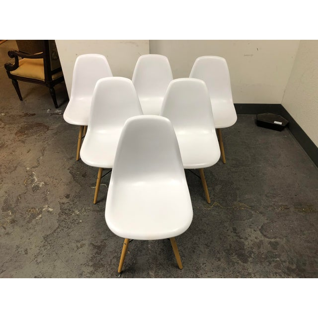 Design Plus Gallery presents a Set of Six Eames Style Eiffel Base Chairs. These are replicas with white molded seats with...