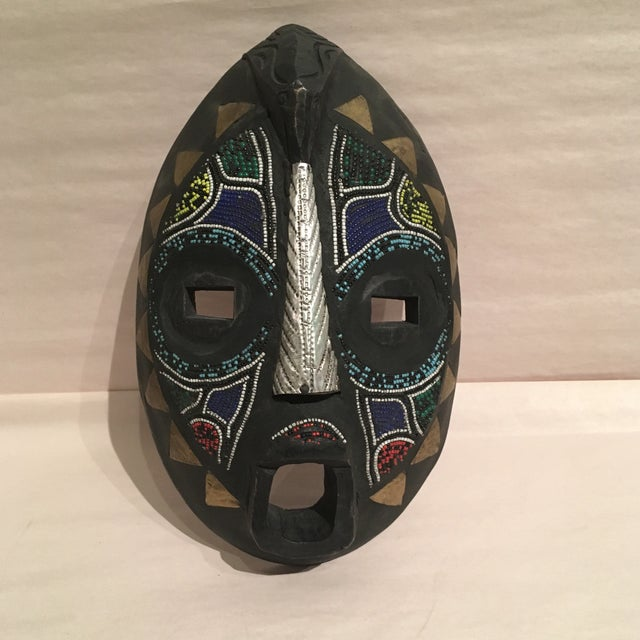 Fabulous handcrafted Mask made of wood with intricate bead detail. This would be the perfect addition to any wall or a...