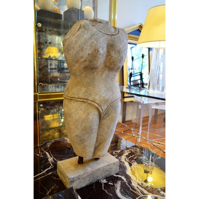 A stately Indian style marble sculpture mounted on a base. It's exact age and origin are unknown. The sculpture is nicely...