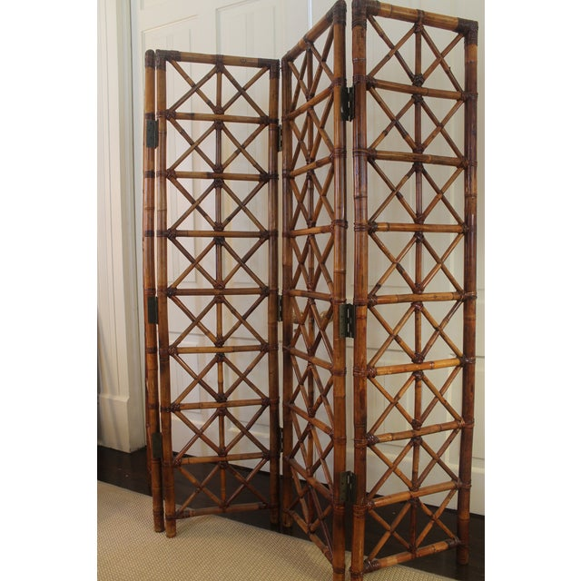 Beautiful 4 panel bamboo screen stands 6 feet tall. Amazing condition and sturdy construction. vintage screen purchased in...