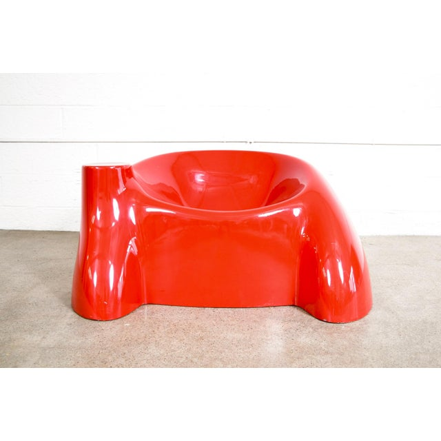 This striking mid century modern Wendell Castle lounge chair was designed and produced circa 1970. Similar to Castle's...