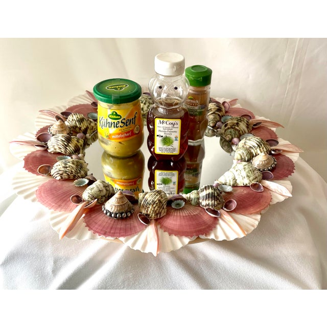 Fun and festive lazy susan for your dining or dressing table! Serve your mustards or show off perfumes on this mirrored...