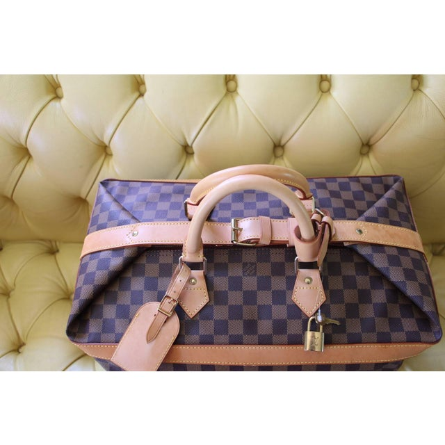 This beautiful Louis Vuitton damier travel bag is a special edition as it has been produced in 1996 to celebrate the 100th...