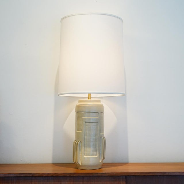 Capsule Table lamp Ceramic with satin glaze, unlacquered brass. (shade not included) Jenny Poston began working in...
