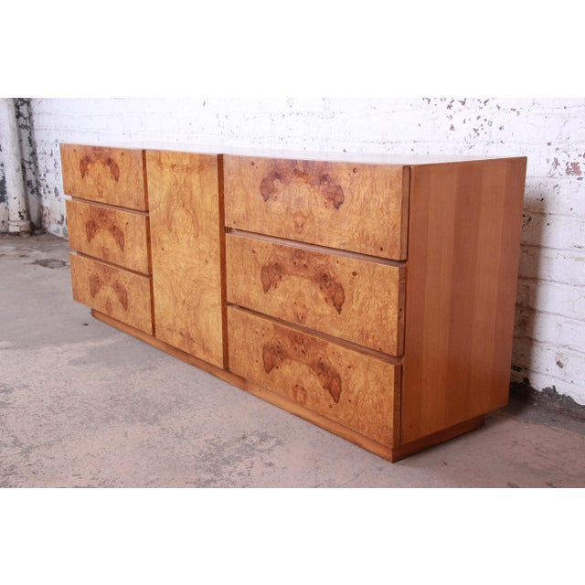 An outstanding Milo Baughman style mid-century modern burl wood long dresser or credenza by Lane Furniture. The dresser...