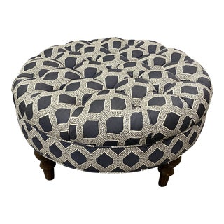 Custom Tufted Round Ottoman With Turned Leg For Sale