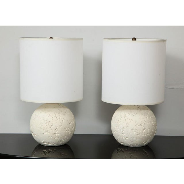 Pair of textured custom circular plaster lamps.
