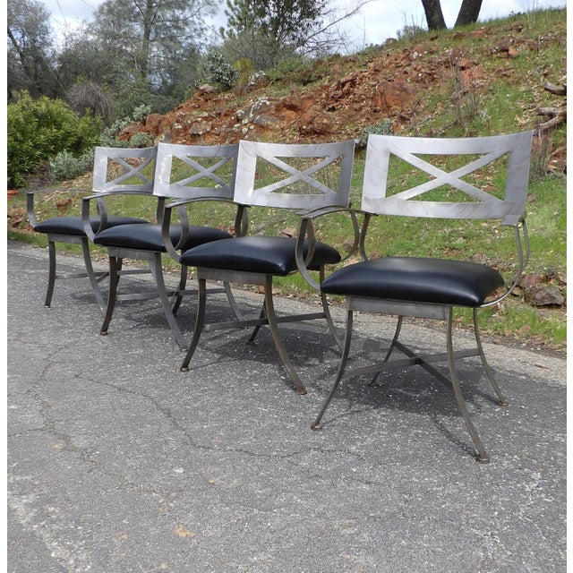 "Beautiful Shaver Howard Steel Chairs. Brushed metal design in the classic Arthur Umanoff ""X"" Pattern. The chairs had some..."