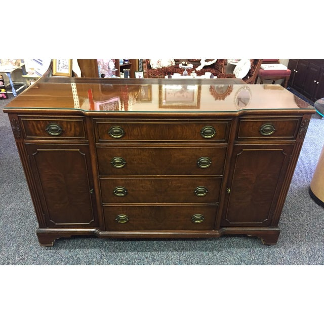 Rich colored mahogany, solid wood Bernhardt sideboard or buffet made in the 1940's. It has quality dovetailed drawers and...