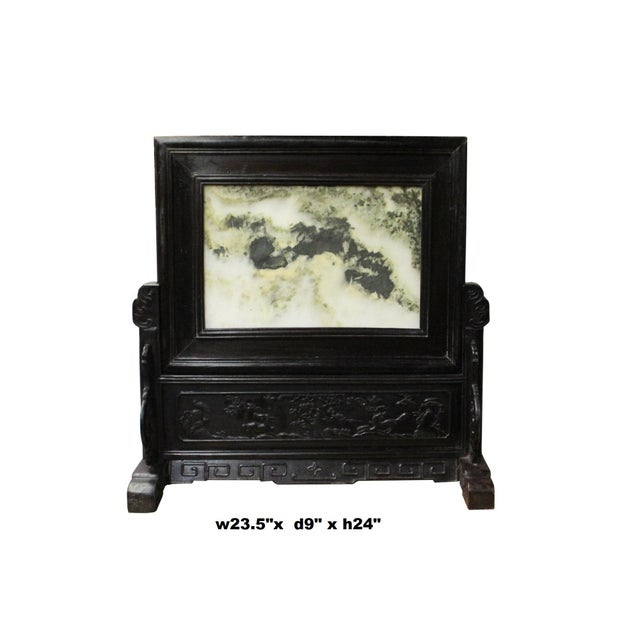 This is a traditional Chinese home decoration piece made of dream stone and framed with rosewood rack. This desktop...
