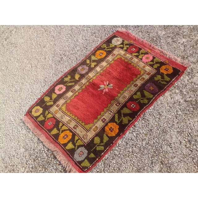 This gorgeous hand-knotted rug was made in about 1940s by Anatolian tribals. Collectible rug is made with all hand spun...