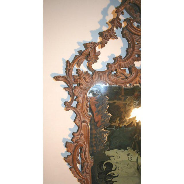 Exuberantly carved Chippendale style mirror of large size. Great presence. Asymmetric carving centering on an eagle with...