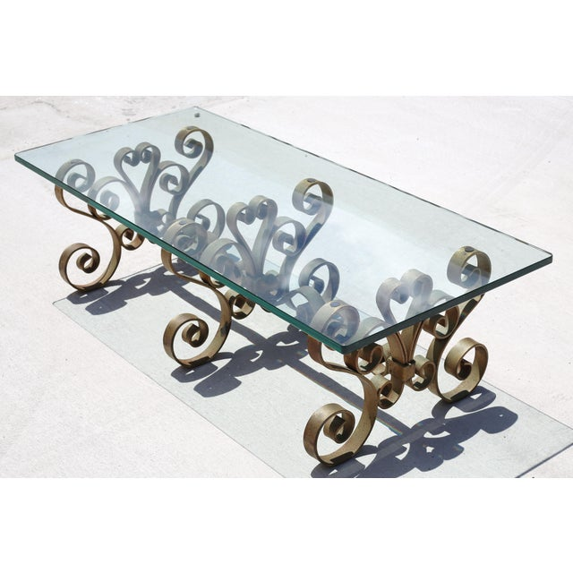 FREE SHIPPING!! This heavy, vintage iron cocktail table is a one-of-a-kind piece. It has a beautiful and varied gold gilt...