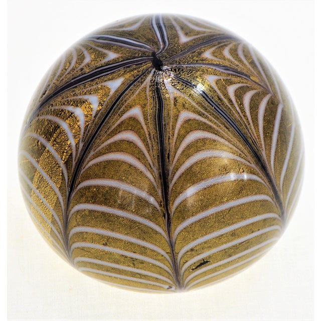 Offering an authentic Murano glass paperweight with gold aventurine by Barovier & Toso, made in Italy, circa 1950s. This...