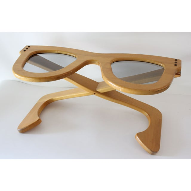 Whimsical wooden coffee table in the form of everyone's favorite iconic thick-rimmed Wayfarer sunglasses. This vintage...