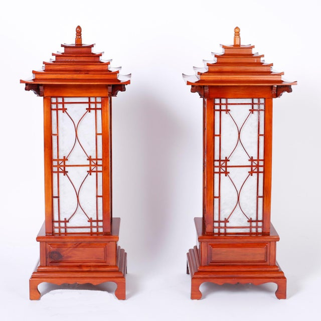 Striking pair of table lamps with a classic pagoda form and strong architectural presence, crafted in pine and each having...