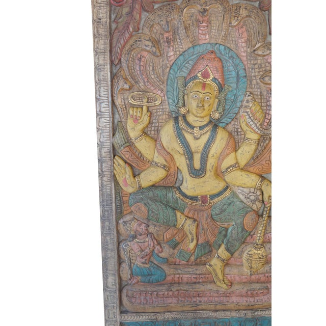 Indian carved wood wall panels of Vishnu is identical to the formless metaphysical concept called Brahman, the supreme,...