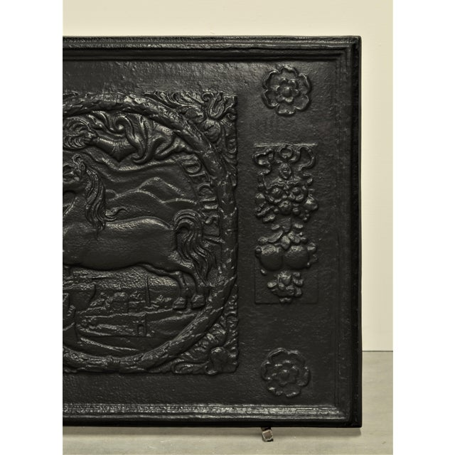 """Very decorative fireback, showing several decorations, jumping horse and """"IN RECTO DECUS"""" meaning """"There is honor in the..."""