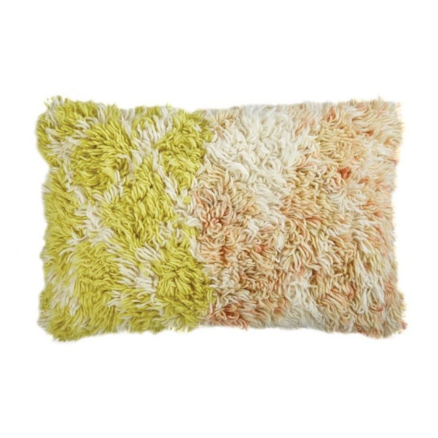 Textured rug pillow in yellow and coral. Solid natural cotton backing. 95% Feather 5% Down Insert. Made in India This...