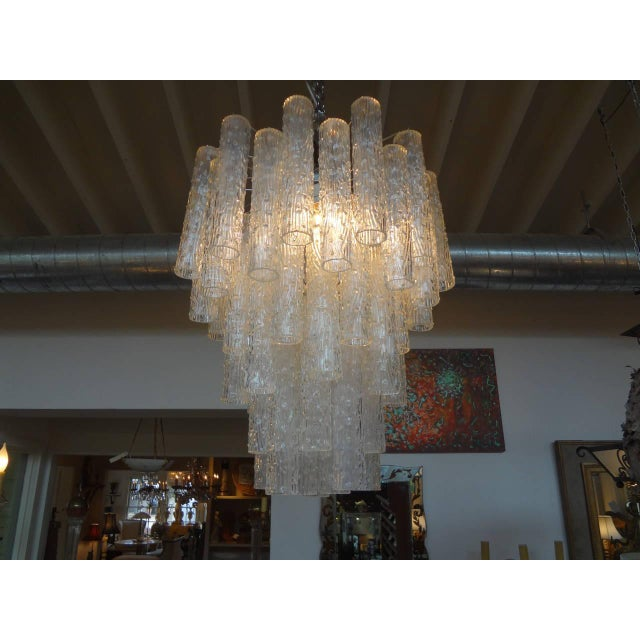 Mid-Century tubular Murano glass chandelier in the style of Venini, Circa. 1960. Can be suspended from a chain if extra...