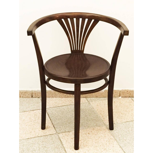 This antique armchair was designed and manufactured in Austria in 1900 by Michael Thonet. It is made of beech and was...