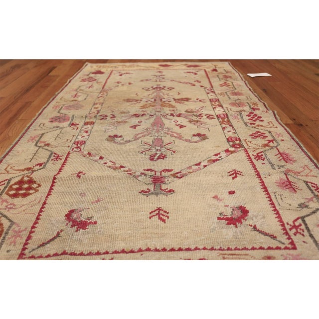 Beautiful antique shabby chic tribal Turkish Ghiordes rug, country of origin: Turkey, date circa 1900. True to many other...