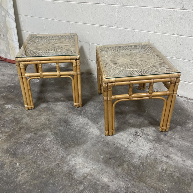 Boho pair of bamboo and wicker side tables with glass tops are perfect for your patio living. Some scuffs and scratches to...