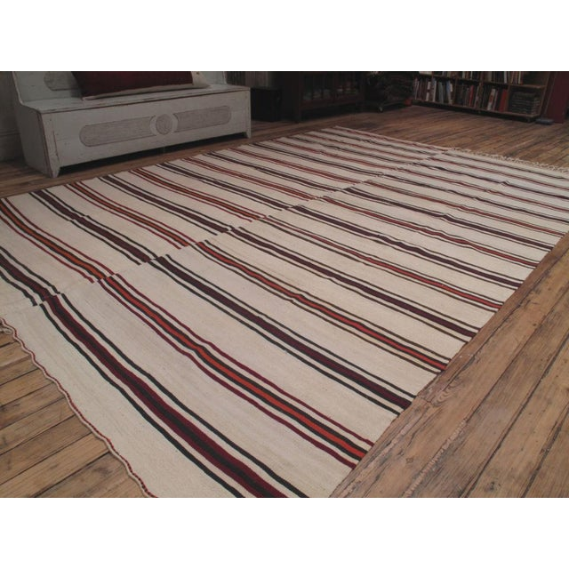 A simple floor cover from central Turkey, woven in two matching panels, which can be separated to make runners. Rare find...