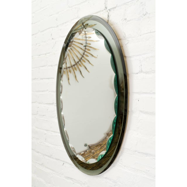 Mirror by Italian maker Cristal Art. Green glass frame with decorative bevels on the edges of the centre mirror.