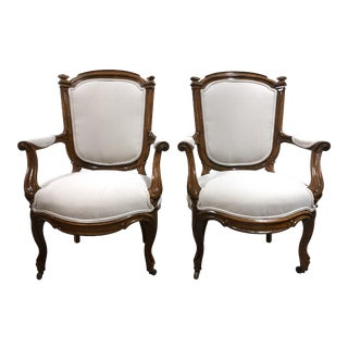 Antique French Louis XVI Style Fruitwood Bergere Armchairs—a Pair For Sale